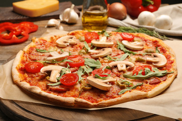 Hot delicious pizza baked in oven on table