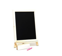 empty blackboard and colored chalks and brush removes the board on white background