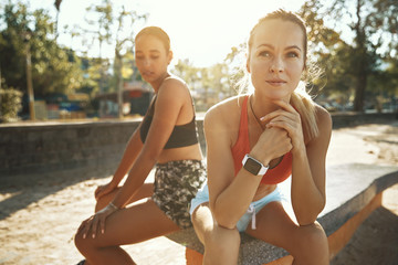 Wall Mural - Two focused friends taking a break from their outdoor workout