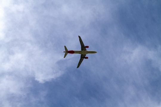 Passenger Airplane flying on cloudy sky