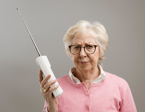 Frustrated senior woman using an old telephone