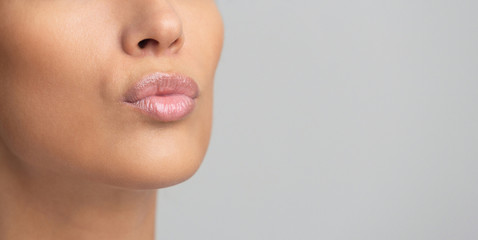 Cosmetics and makeup. Lips with pink gloss