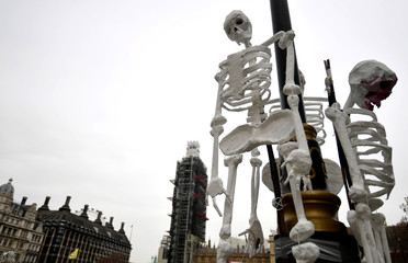 Fake skeletons are seen around Parliament Square during the Extinction Rebellion protest in London