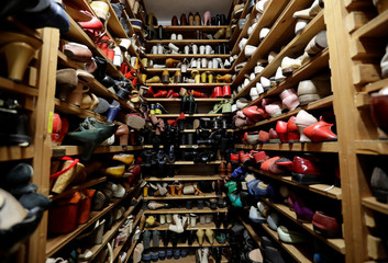 Shoes are placed on shelves in a costume and props storage of the Barrandov Studio in Prague
