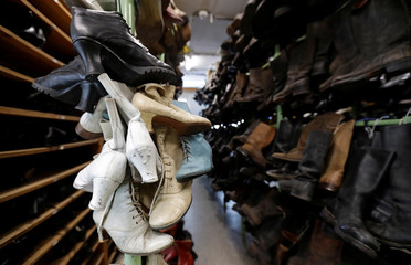 Shoes hang in a costume and props storage of the Barrandov Studio in Prague