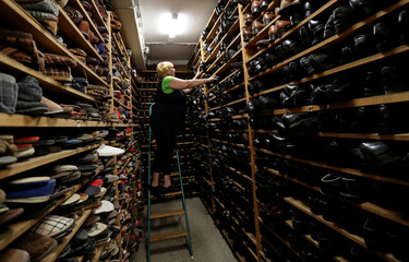 An employee sorts shoes in a costume and props storage of the Barrandov Studio in Prague