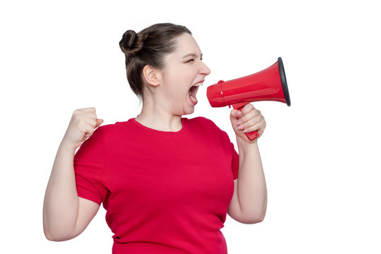 Young woman activist in red t-shirt screaming into a megaphone, isolated on white background.