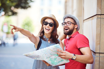 Young couple visiting European city on vacation