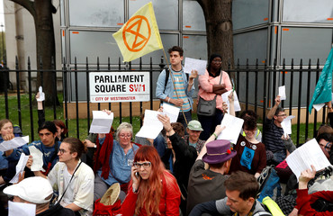 Climate change activists demonstrate around Parliament Square during the Extinction Rebellion protest in London