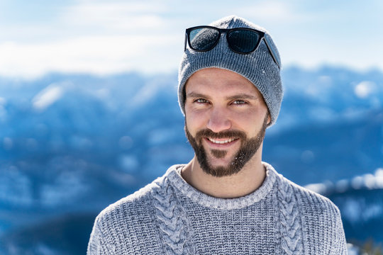 Germany, Bavaria, Brauneck, portrait of smiling man in winter in the mountains
