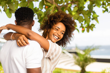 Outdoor protrait of black african american couple embracing each other
