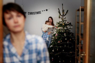 Same sex family celebrating Christmas at home