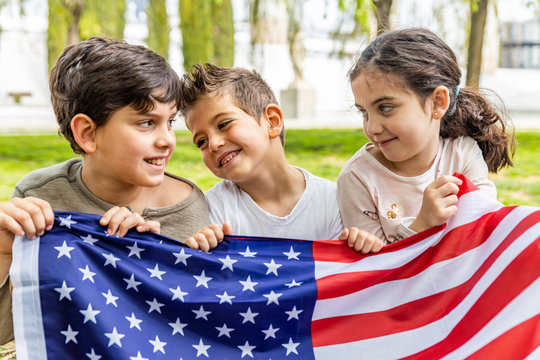 Three kids celebrating 4th of July outdoors