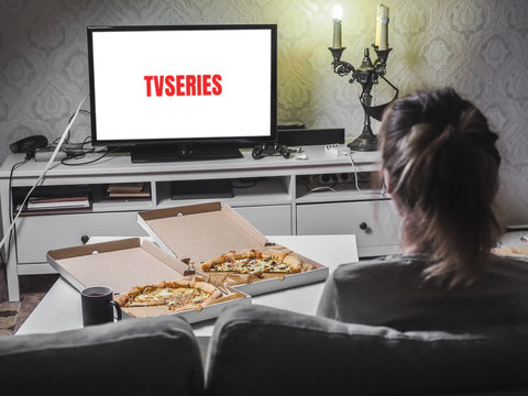Pizza in delivey box with TV series in living room