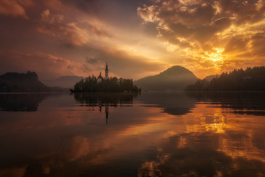 Orange sunset with a magic atmosphere in Bled lake, Slovenia.