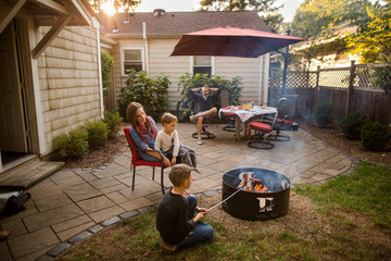 Portrait of a family eating together in back yard