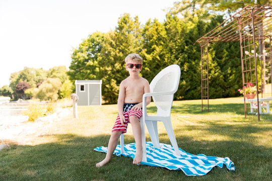 Boy Wears Sunglasses and American Flag Bathing Suit at Lake Michigan