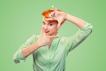 pinup girl woman making framing key gesture