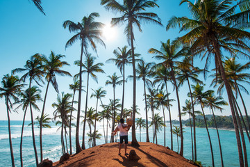 Couple at Coconut tree hill in Mirissa, Sri Lanka Wall mural