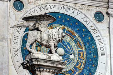 Padova, Italy, historical center, clock tower detail with venetian lion