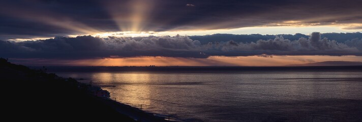 Panorama of dramatic sunrise over the  Los Angeles skyline with light rays