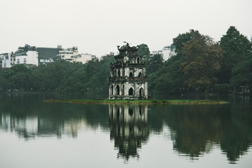 Hoan Kiem Lake, the little lake in the old part of Hanoi, Vietnam, with the Turtle Tower. Turtle Tower is the symbol of Hanoi,Vietnam Wall mural