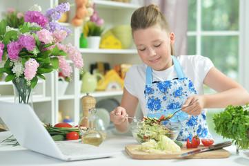 Portrait of cute teen girl preparing fresh salad