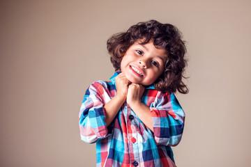 Portrait of a cute little smiling boy. Children, emotions concept