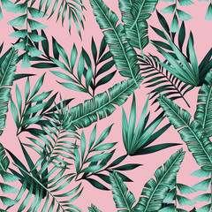 Exotic green tropical leaves seamless pattern pink background