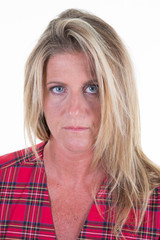 Close-up portrait of serious middle aged 40 woman looking at camera