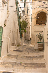 Fototapeta Italy, Ostuni, a typical street in the ancient historic center