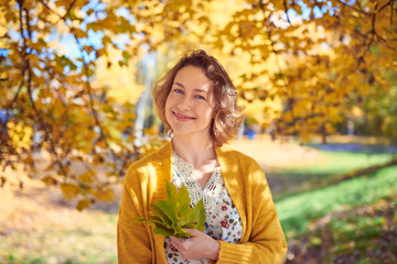 Pretty woman portrait in autumn park