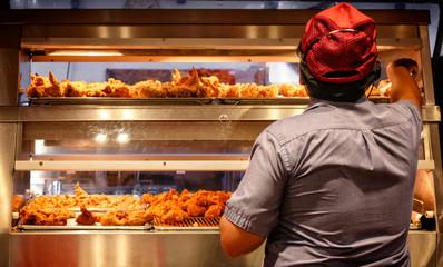 Minimum Wage Employee Works in a Fast Food Kitchen.
