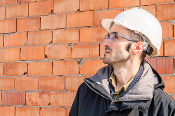 Portrait of an engineer wearing hardhat at the construction site
