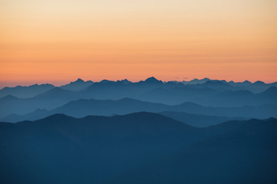 shadows of the moutains during a sunrise in pyrenees region, Occitanie, La Mongie, France