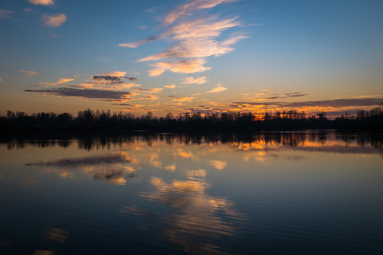 a lake during a sunset, Haute-Garonne, Roques, France
