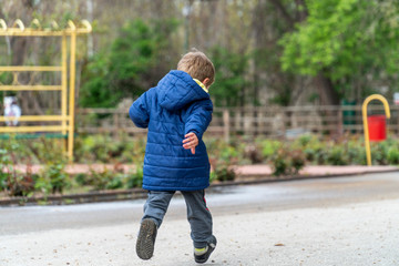 Small child running in a park