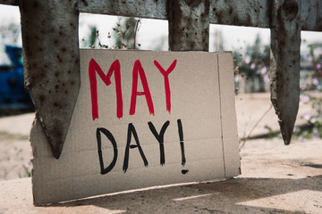 text may day in a brown cardboard signboard