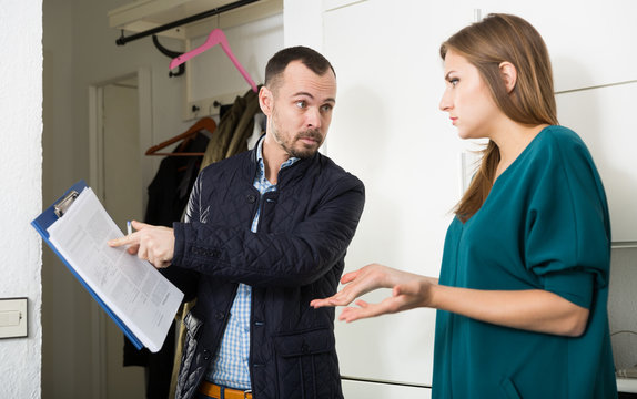 Frustrated woman talking to debt collector