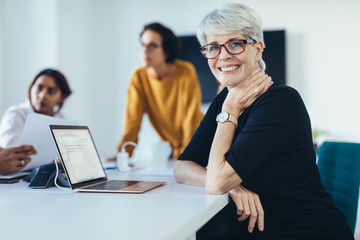 Successful mid adult woman at meeting