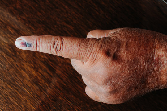 Closeup shot of the finger of the Indian man who cast his vote