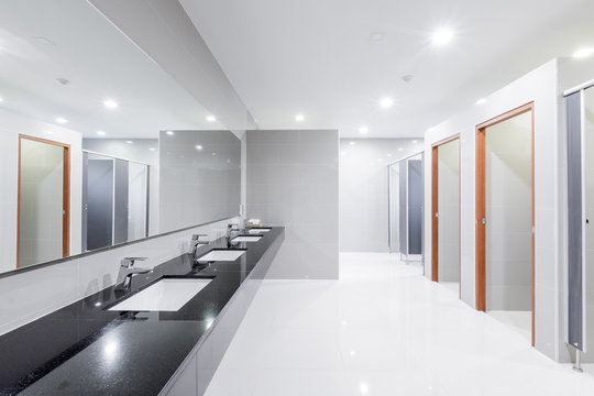 public Interior of bathroom with sink basin faucet lined up Modern design.