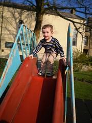 Toddler boy on the slide
