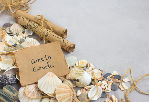 Summer time sea vacation, seashells on a gray background, the words of the letter time to travel, beach relax