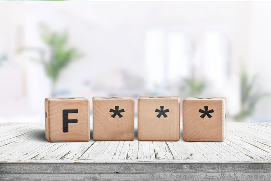 The F word censored on a wooden sign