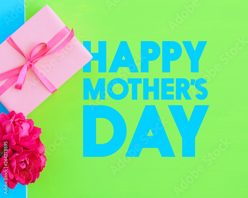 Happy Mother's Day gift on bright green background.  Text for card or graphic, holiday concept.