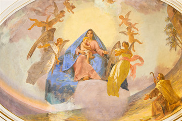 Fototapete - CATANIA, ITALY - APRIL 7, 2018: The fresco of Madonna in among the angels in church Santuario Madonna del Carmine by  Natale Attanasio (1898).