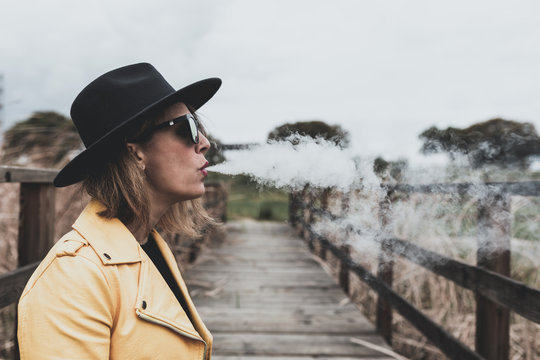 Girl with black hat and yellow jacket