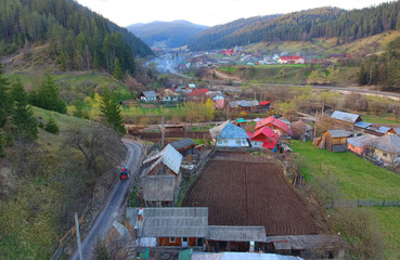aerial view of village in the spring. counrtyside of Poiana Teiului, Romania