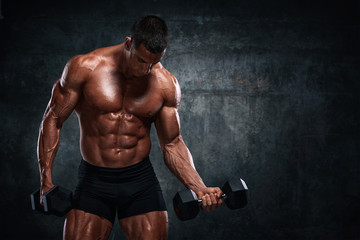 Bodybuilder Exercise With Dumbbells. Performing Dumbbell Curls for biceps